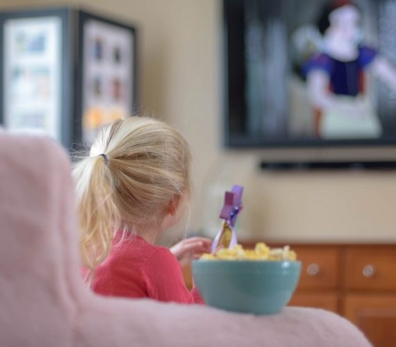 little-girl-watching-a-movie-on-tv-at-home-kid-kids-child-movie-night-children-tv-television-watching_t20_goLp0a